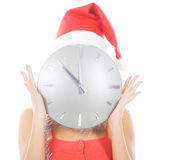 Woman in santa hat with big clock Stock Image