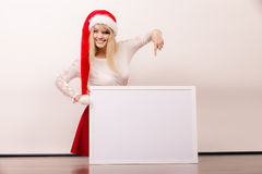 Woman in santa hat with blank banner. Copy space. Royalty Free Stock Photography