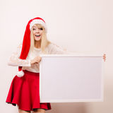 Woman in santa hat with blank banner. Copy space. Stock Photography