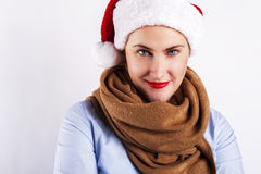 Woman in santa hat blinking one eye. Smiling over white. Stock Images