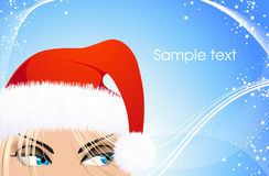 Woman with Santa hat on blue Christmas background Royalty Free Stock Photo