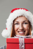 Woman in a Santa hat with a Christmas gift Stock Photo