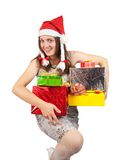Woman in a santa hat with Christmas gifts Royalty Free Stock Images