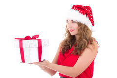Woman in santa hat with christmas present isolated on white Stock Images