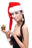 Woman in santa hat with Christmas present smiling Royalty Free Stock Photo