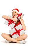 Woman in Santa hat with Christmas presents Stock Images