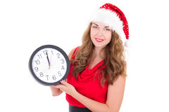 Woman in santa hat with clock isolated on white Royalty Free Stock Image