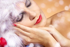 Woman with santa hat close up Royalty Free Stock Images