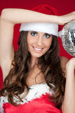 Woman with santa hat and disco ball Royalty Free Stock Image