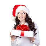 Woman in santa hat dreaming Royalty Free Stock Image
