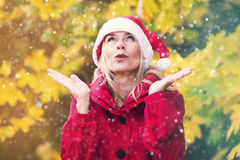 Woman with Santa hat enjoying first snow Stock Images