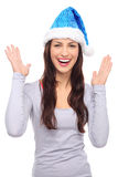 Woman in Santa hat gesturing Royalty Free Stock Image