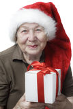Woman in Santa hat with gift Stock Photography