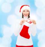 Woman in santa hat with gift box and stocking Royalty Free Stock Photo