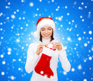 Woman in santa hat with gift box and stocking Stock Photography