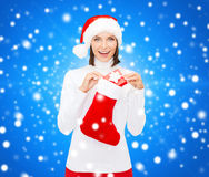 Woman in santa hat with gift box and stocking Stock Photo