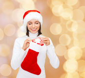 Woman in santa hat with gift box and stocking Royalty Free Stock Photos