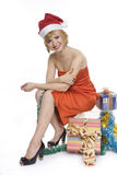 Woman in  Santa hat with gifts Royalty Free Stock Photo