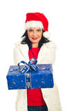 Woman with Santa hat giving present Royalty Free Stock Images