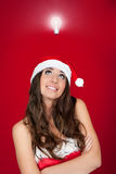 Woman with santa hat got an idea Royalty Free Stock Images