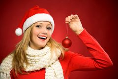 Woman in Santa hat holding christmas ball Royalty Free Stock Images