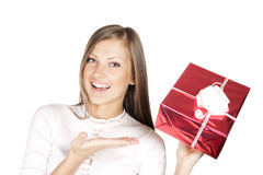 Woman in santa hat holding christmas gift Royalty Free Stock Images
