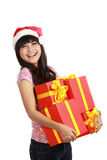 Woman in Santa hat holding Christmas gifts Royalty Free Stock Image