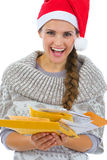 Woman in Santa hat holding Christmas letters Royalty Free Stock Images