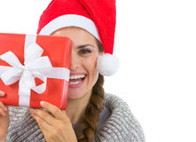 Woman in Santa hat holding Christmas present Royalty Free Stock Photo