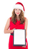 Woman in santa hat holding clipboard with copyspace isolated on Stock Photography
