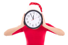 Woman in santa hat holding clock over white Stock Images