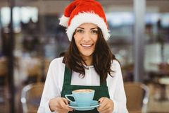 Woman with santa hat holding coffee Stock Photography