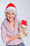 Woman in Santa hat holding cute rabbit Stock Photos