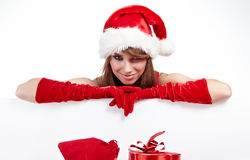 Woman in santa hat holding empty board Stock Images