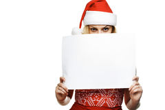 Woman in santa hat holding empty board Stock Photo
