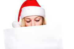 Woman in santa hat holding empty board Royalty Free Stock Photo