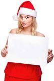 Woman in santa hat holding empty board Stock Photography