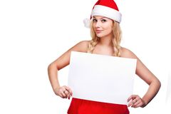 Woman in santa hat holding empty board Royalty Free Stock Image