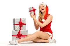 Woman in Santa hat holding gifts Royalty Free Stock Image