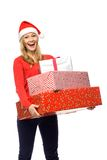 Woman in Santa hat holding gifts Royalty Free Stock Images