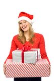 Woman in Santa hat holding gifts Royalty Free Stock Photography