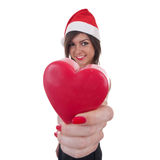 Woman in Santa hat holding a heart Stock Images