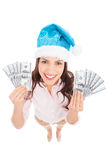 Woman in Santa hat holding money Stock Photography