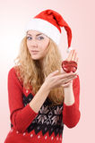 Woman in Santa hat holding red heart royalty free stock photos