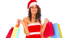 Woman in Santa hat holding shopping bag stock footage
