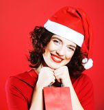 Woman with Santa hat holding shopping bag, Stock Photos