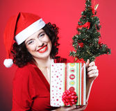 Woman with Santa hat holding shopping bags Royalty Free Stock Photo