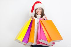 Woman in santa hat holding shopping bags Stock Photography