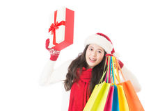 Woman in santa hat holding shopping bags excited Royalty Free Stock Photos