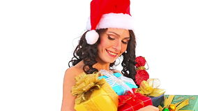 Woman in Santa hat holding stack gift box stock video footage